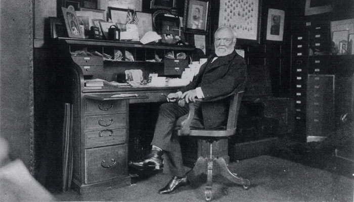 Andrew Carnegie at a desk