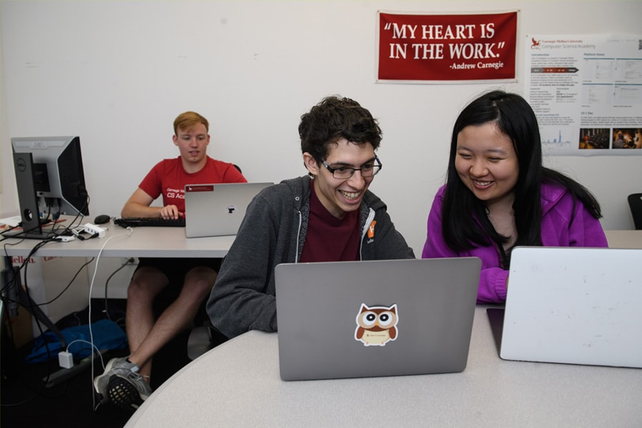 A photo of students at a computer