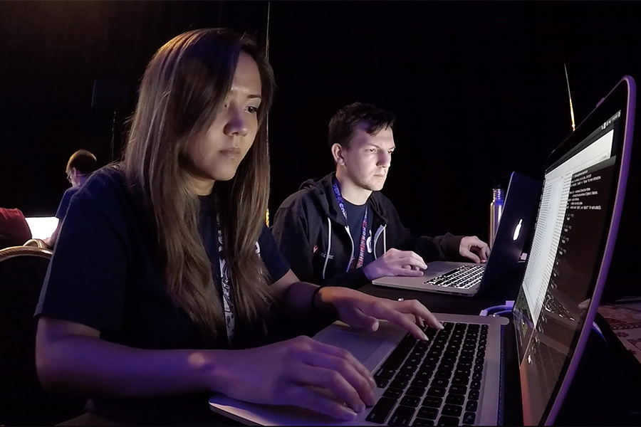 Image of two team members at their laptops.