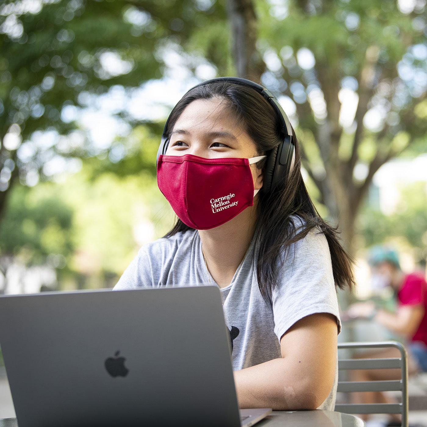 A photo of a student in a mask