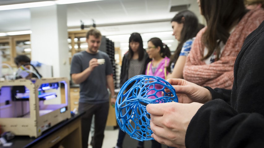 students in lab with 3D model