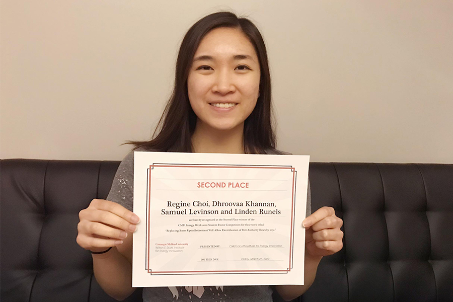 CMU student Regine Choi displays her award certificate for the CMU Energy Week Student Research Poster Competition.
