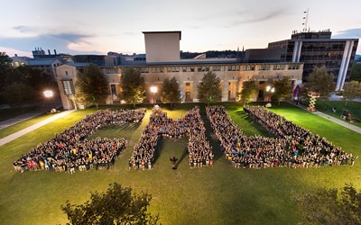 "students form ""CMU"" on Cut"