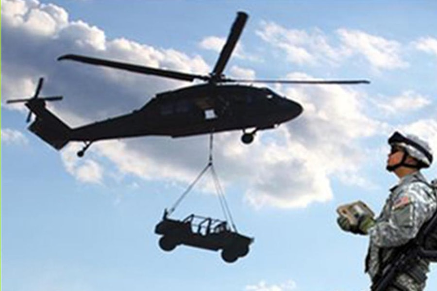 Image of an autonomous helicopter carrying a truck