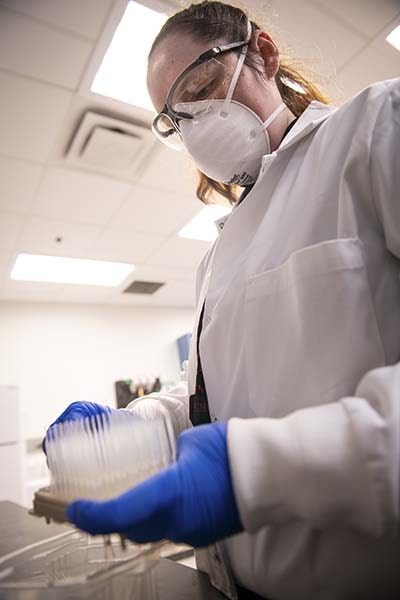 A photo of a lab worker