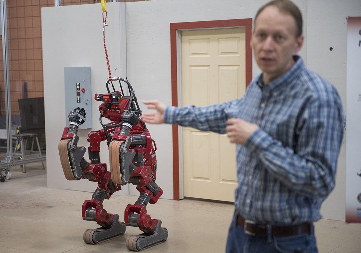 Principal Robotics Engineer Michael Vande Weghe delivers information about CHIMP, the CMU Highly Intelligent Mobile Platform robot, during a tour of the National Robotics Engineering Center in 2017.