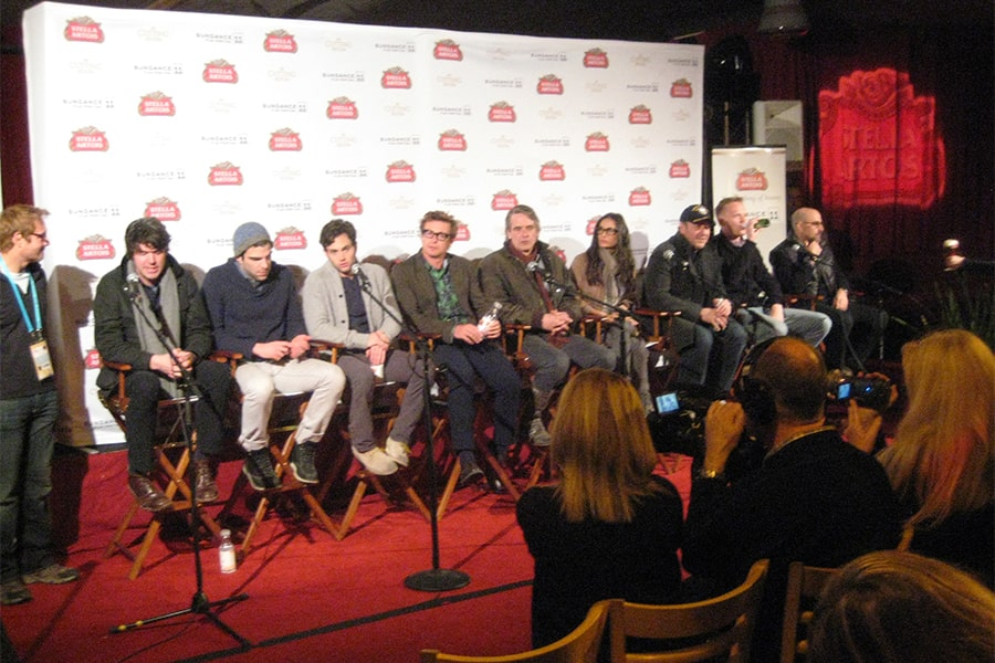 actors and producers of Margin Call movie seated side by side on a stage